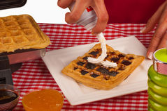 Cream on waffles Stock Images
