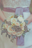 Cream wedding bouquet. Bride with a cream wedding bouquet Royalty Free Stock Image