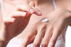 Cream on the women hand royalty free stock photography