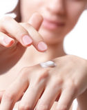 Cream on the women hand Stock Photo