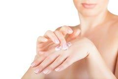 Cream on the women hand Royalty Free Stock Image