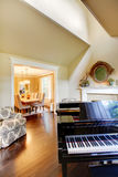Cream yellow living room with grand piano. Stock Image