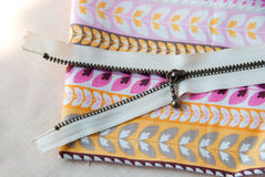 A zipper on sweet cotton . A cream zipper on the sweet cotton fabric stock photo