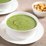 Cream of Zucchini Soup. Fresh cream of zucchini soup with olive oil on top served in bowls, photographed with natural light Selective Focus, Focus one third into royalty free stock photo