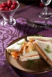 Creamcheese salmon sandwiches. Delicious sandwiches with salmon and creamcheese stacked on a plate Stock Image