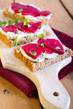 Creamcheese and sliced beetroot. Slices of bread with herb creamcheese and sliced beetroot royalty free stock photos