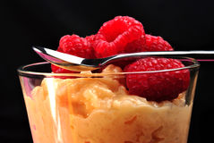 Creamed rice pudding with raspberries Stock Photo