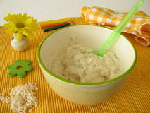 Creamed rice for small children Stock Images