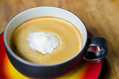 Creamer on a cup of coffee Royalty Free Stock Image