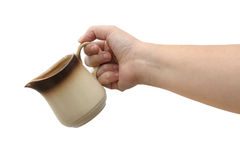 Creamer & hand Stock Photos