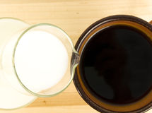 Creamer pouring into coffee Stock Photo