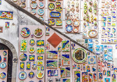 Creamics for sale. Colorful building and  with ceramic plates for sale in Amalfi, Italy Stock Photography