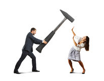 Creaming man and scared woman. Angry screaming men holding big hammer and hitting scared woman. isolated on white background Royalty Free Stock Photos