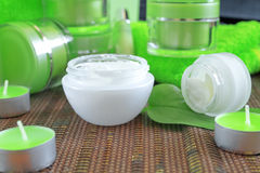 Creams for body care. In transparent and green containers Royalty Free Stock Photos