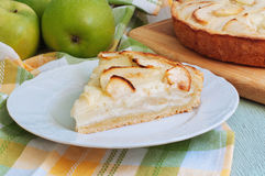 Creamy Apple Pie. On a light green wood background Stock Images