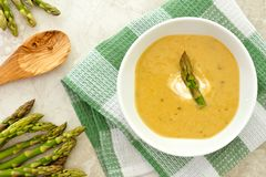 Creamy asparagus soup overhead setting over white granite Stock Photography