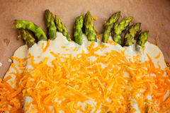 Creamy baked asparagus and aged cheddar redy for oven Royalty Free Stock Photos
