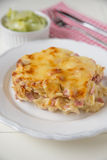 Creamy baked pasta with bacon and cheese Stock Images