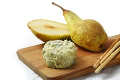 Creamy blue stilton cheese, pears and cracker sticks on a cuttin Royalty Free Stock Images