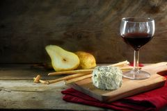 Creamy blue stilton cheese, port wine, pears and some cracker st Stock Photos