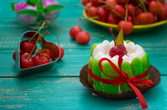 Creamy cake with cherries. Wooden turquoise background. Top view. Close-up Royalty Free Stock Photos