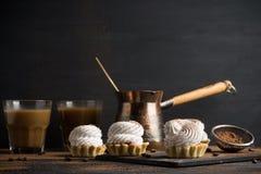 Creamy cake on the dark rustic background. Stock Photo