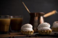 Creamy cake on the dark rustic background. Royalty Free Stock Photo