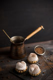 Creamy cake on the dark rustic background. Stock Photography