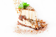Creamy cake decorated with walnuts caramel Royalty Free Stock Images