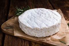 Creamy Camembert on wooden background Royalty Free Stock Image