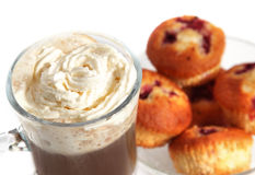 Creamy cappuccino with muffins Stock Photography