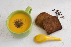 Creamy Carrot and Cauliflower Soup with Toast. Homemade Creamy Carrot and Cauliflower Soup with Toast and Black Pepper Stock Photography