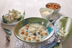 Creamy cauliflower soup in a blue cup with croutons and parmesan Royalty Free Stock Image