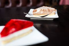 Creamy cheasecake with a spoon. Another cheasecake in foreground out of focus Stock Photography