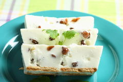 Creamy cheesecake with nuts an Stock Photos