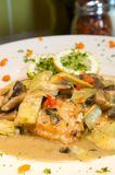 Creamy chicken with artichokes. An image of a creamy chicken and artichoke dish Stock Image