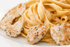 Creamy Chicken Fettuccini. Pasta with detail on wood table Royalty Free Stock Photography