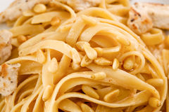 Creamy Chicken Fettuccini. Pasta with detail on wood table Stock Photo