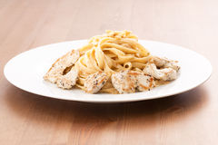 Creamy Chicken Fettuccini. Pasta with pork on wood table Stock Image
