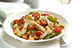 Creamy Chicken and Spinach Pasta. With roasted cherry tomatoes and shaved parmesan.  Delicious healthy eating Stock Photos