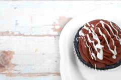 Creamy chocolate cupcake Stock Image
