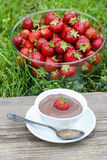 Creamy chocolate pudding on wooden table Royalty Free Stock Images