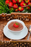 Creamy chocolate pudding on wooden tray Stock Photography