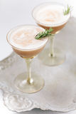 Creamy cocktails garnished with rosemary Royalty Free Stock Photo