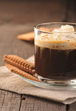 Creamy coffee and cookies Stock Images