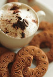 Creamy coffee and cookies Stock Photography