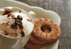 Creamy coffee and cookies Stock Image
