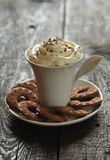 Creamy coffee and cookies Royalty Free Stock Photo