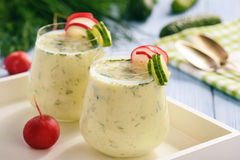 Creamy cold yogurt soup with vegetables served in glasses. Royalty Free Stock Image