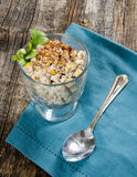 Creamy Corn Salad. A bowl of Corn Salad on a blue napkin with spoon Royalty Free Stock Photo